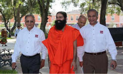 Swami Ramdevji with the Chairman & CEO of Park Square Home